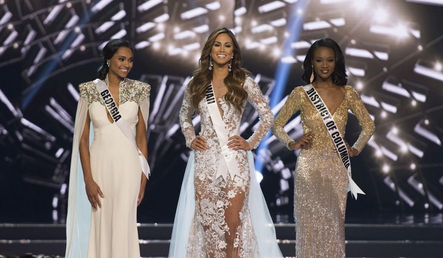 Finalists Miss Hawaii Chelsea Hardin, center, Miss District of Columbia Deshauna Barber, right, and Miss Georgia Emanii Davis, left, stand during the 2016 Miss USA pageant in Las Vegas, Sunday, June 5, 2016. (Jason Ogulnik/Las Vegas Review-Journal via AP) LOCAL TELEVISION OUT; LOCAL INTERNET OUT; LAS VEGAS SUN OUT