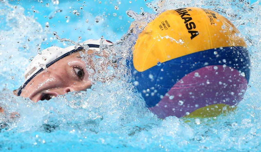 File - In this Aug. 7, 2015, file photo, United States' Kaleigh Gilchrist controls the ball during the women's water polo final match between Netherlands and the U.S. at the Swimming World Championships in Kazan, Russia. Kaleigh Gilchrist could be traveling the world right now with her surfboard, competing for money in exotic locations. Instead she is training hard for the Rio Olympics, hoping to win gold with the U.S. women's water polo team.  (AP Photo/Denis Tyrin, File)