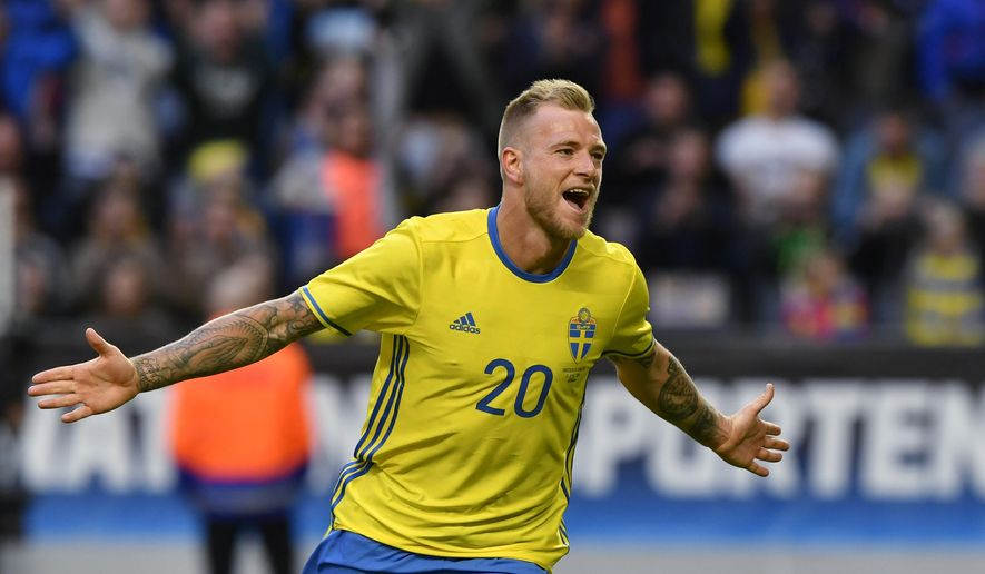 Sweden's John Guidetti celebrates after scoring Sweden's third goal during the friendly soccer match Sweden vs Wales at the Friends Arena in Stockholm, Sweden, Sunday, June 5, 2016. (Anders Wiklund/TT via AP)  SWEDEN OUT