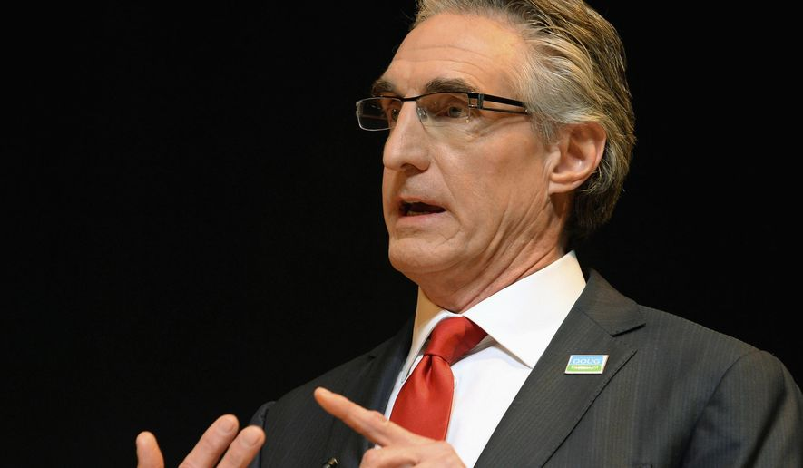 FILE - In this March 3, 2016, file photo, Republican gubernatorial hopeful Doug Burgum speaks during at a debate in Bismarck, N.D. Burgum, a former Microsoft executive and entrepreneur, is considered an underdog in the June 14 Republican primary race against longtime Attorney General Wayne Stenehjem. Stenehjem has the party's endorsement and more statewide recognition than his wealthy opponent. (Will Kincaid/The Bismarck Tribune via AP) MANDATORY CREDIT