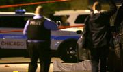 In this May 30, 2016, file photo, police work the scene where a man was fatally shot in the chest in Chicago's Washington Park neighborhood. (E. Jason Wambsgans/Chicago Tribune via AP)