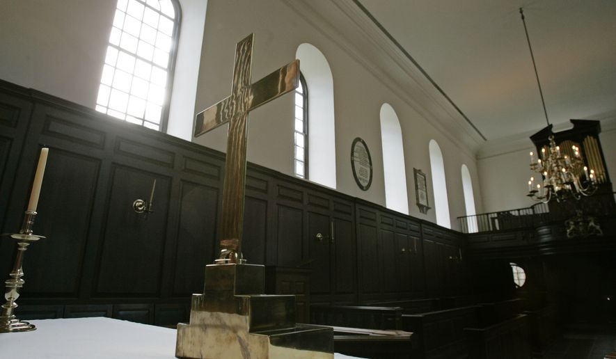 **FILE**  A cross sits on a table used as an altar in the Wren Chapel on the Campus of William & Mary in Williamsburg, Va., Friday, Jan. 26, 2007. The cross is the subject of a controversy after president Gene Nichol ordered the cross put in storage. Nichol ordered the cross removed last October to make the chapel more inviting to people of all faiths. (AP Photo/Steve Helber, File)