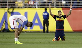 Colombia's Jeison Murillo, right, celebrates next to United States' Clint Dempsey after a 2-0 Colombia win during a Copa America Centenario Group A soccer match at Levi's Stadium in Santa Clara, Caif., Friday, June 3, 2016.(AP Photo/Marcio Jose Sanchez)