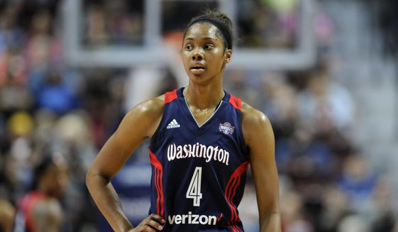 FILE - In this May 21, 2016, file photo, Washington Mystics' Tayler Hill watches during the second half of a WNBA basketball game against the Connecticut Sun in Uncasville, Conn. When Hill told Mike Thibault she was pregnant after her rookie season in the WNBA, the Mystics' coach and general manager offered immediate support. Almost three years later, that support is being rewarded in a big way as Hill has evolved into a more complete player than she was before giving birth to her son, Maurice. (AP Photo/Jessica Hill) ** FILE **