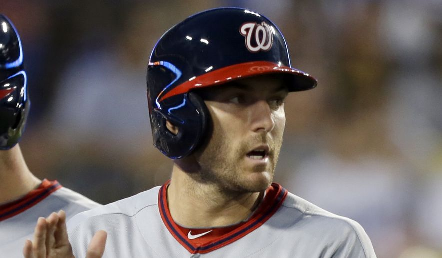 Washington Nationals Steve Lombardozzi, left, and Jordan Zimmermann score on a Ryan Zimmerman double  against the Los Angeles Dodgers in the third inning of a baseball game in Los Angeles Monday, May 13, 2013. (AP Photo/Reed Saxon)