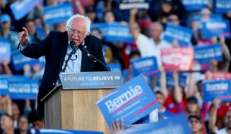 Democratic presidential candidate Sen. Bernie Sanders, I-Vt. speaks during a campaign rally at Qualcomm Stadium on Sunday, June 5, 2016 in San Diego.(AP Photo/Sandy Huffaker)