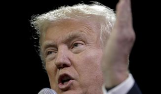 "FILE - in this May 27, 2016 file photo, Republican presidential candidate Donald Trump speaks at a rally in Fresno, Calif. Trump says he made ""a lot of money"" in a deal years ago with Moammar Gadhafi, despite suggesting at the time he had no idea the former Libyan dictator was involved in renting his suburban New York estate. (AP Photo/Chris Carlson, File)"