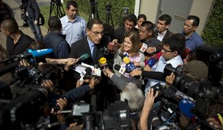 Mercedez Araoz, right, and Martin Vizcarra, the running mates of presidential candidate Pedro Pablo Kuczynski, talk to reporters outside Kuczynski 's home in Lima, Peru, Monday, June 6, 2016. Kuczynski had a razor-thin lead over his rival Keiko Fujimori, the daughter of jailed former strongman Alberto Fujimori, as Peruvians awaited results still trickling in from remote parts of the Andean nation. (AP Photo/Rodrigo Abd)