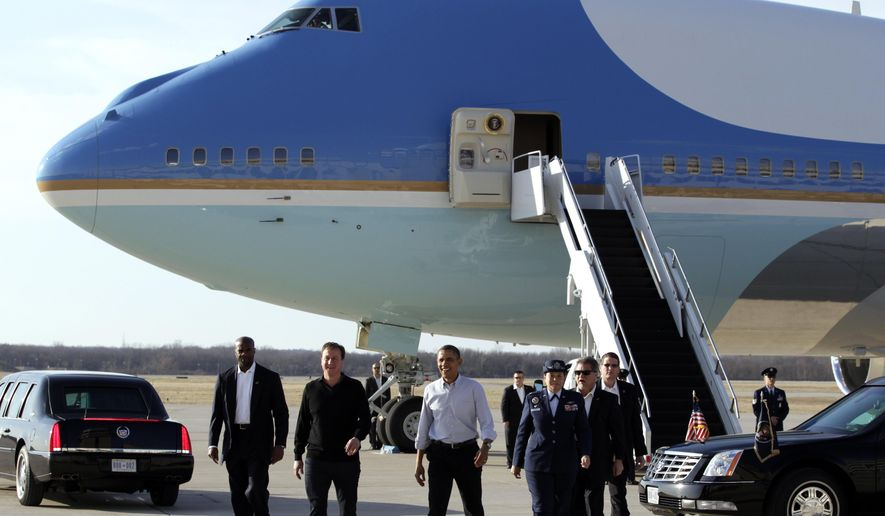In this March 13, 2012, file photo, President Barack Obama and Britain's Prime Minister David Cameron, arriving for a first-round NCAA tournament basketball game, walk away from Air Force One at Wright-Patterson Air Force Base near Dayton, Ohio. The National Museum of the U.S. Air Force, located on Wright-Patterson Air Force Base, may someday add one of the two VC-25 presidential aircraft now serving as Air Force One to the museum's collection, and officials kept that possibility in mind while designing the museum's fourth building, a $40.8 million, 224,000-square-foot hangar scheduled to open Wednesday, June 8, 2016, according to the Dayton Daily News. (AP Photo/Carolyn Kaster, File)