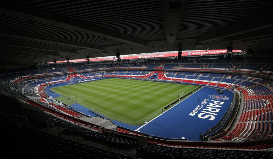 In this photo taken on Tuesday, May 10, 2016, The Parc Des Princes stadium, recently renovated, is pictured in Paris. The stadium is a venue for the Euro 2016 soccer tournament. (AP Photo/Christophe Ena) ** FILE **