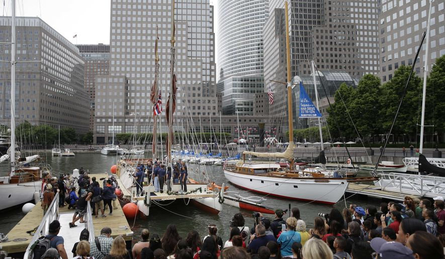 Crew members of the Hawaiian voyaging canoe Hokulea prepare to disembark at port in New York, Sunday, June 5, 2016. The Hokulea is sailing around the world to promote environmental sustainability and conservation. Among other activities, the crew will celebrate World Oceans Day with United Nations dignitaries while visiting New York. (AP Photo/Seth Wenig)