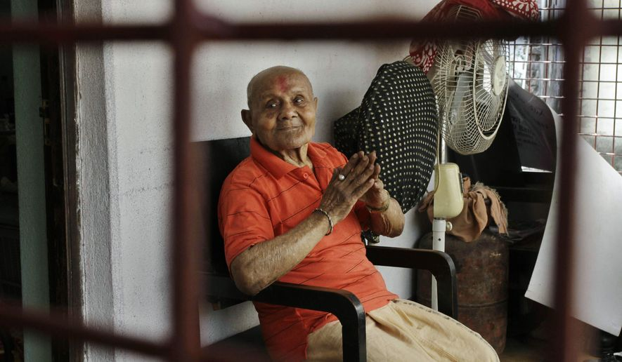 FILE - In this March 18, 2012 file photo, Indian body builder Manohar Aich poses for a photograph at his home in Kolkata, India. Aich, a celebrated Indian bodybuilder and former Mr. Universe, has died in the eastern city of Kolkata at the age of 104. Aich's son said his father died Sunday, June 5, 2016 from health issues related to his age. (AP Photo/Bikas Das, File)
