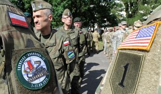 Polish Army and U.S. Army soldiers attend the opening ceremony of the Anaconda-16 military exercise, in Warsaw, Poland, Monday, June 6, 2016. Poland and some NATO members are launching their biggest ever exercise, involving some 31,000 troops, as central and eastern European nations are seeking strong security guarantees among concerns about Russia's assertiveness and actions. (AP Photo/Alik Keplicz)