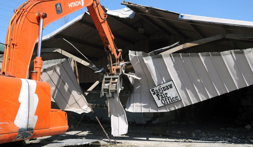 In a April 23, 2009 photo, Ground Zero Contracting of Saginaw demolishes the Saginaw Fair Office at the old Saginaw County Fairgrounds in Saginaw, Mich. Plans could transform the blighted former fairgrounds in Saginaw into a park. (Jeff Schrier/Saginaw News via AP)