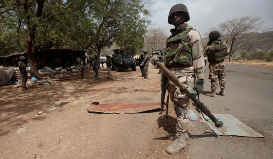 Nigerian soldiers man a checkpoint in Gwoza, Nigeria, a town newly liberated from Boko Haram, on April 8, 2015. (Associated Press)