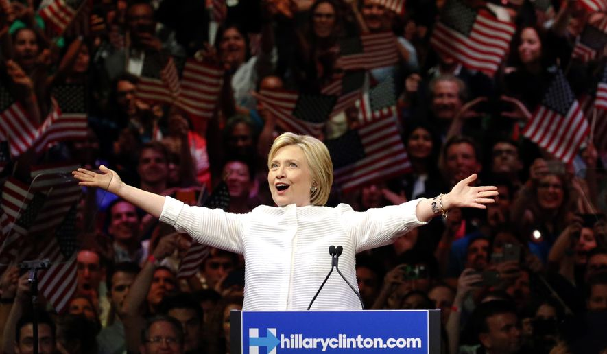 Democratic presidential candidate Hillary Clinton greets supporters during a presidential primary election night rally, Tuesday, June 7, 2016, in New York. (AP Photo/Julio Cortez)