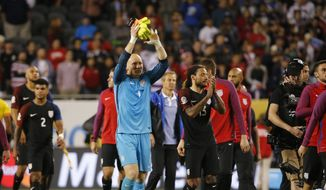 United States goalkeeper Brad Guzan (1) celebrates after United States defeated Costa Rica, 4-0, in a Copa America Centenario group A soccer match at Soldier Field in Chicago, Tuesday, June 7, 2016. (AP Photo/Charles Rex Arbogast)