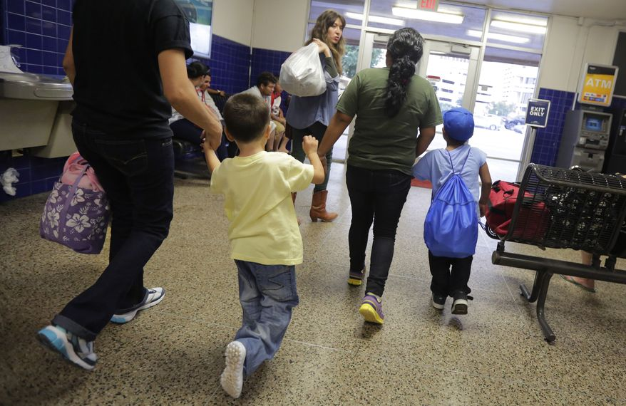 Immigrants from El Salvador who entered the country illegally walk through a bus station after they were released from a family detention center in San Antonio, Texas. (Associated Press)