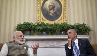 President Barack Obama listens as Indian Prime Minister India Narendra Modi speaks to members of the media during their meeting in the Oval Office of the White House in Washington, Tuesday, June 7, 2016. (AP Photo/Pablo Martinez Monsivais)