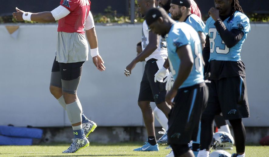 Carolina Panthers' Cam Newton, left, dances as they team stretches during an NFL football practice in Charlotte, N.C., Tuesday, June 7, 2016. (AP Photo/Chuck Burton)