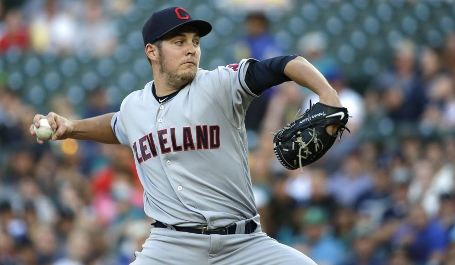 Cleveland Indians starting pitcher Trevor Bauer throws against the Seattle Mariners in the first inning of a baseball game, Monday, June 6, 2016, in Seattle. (AP Photo/Ted S. Warren)