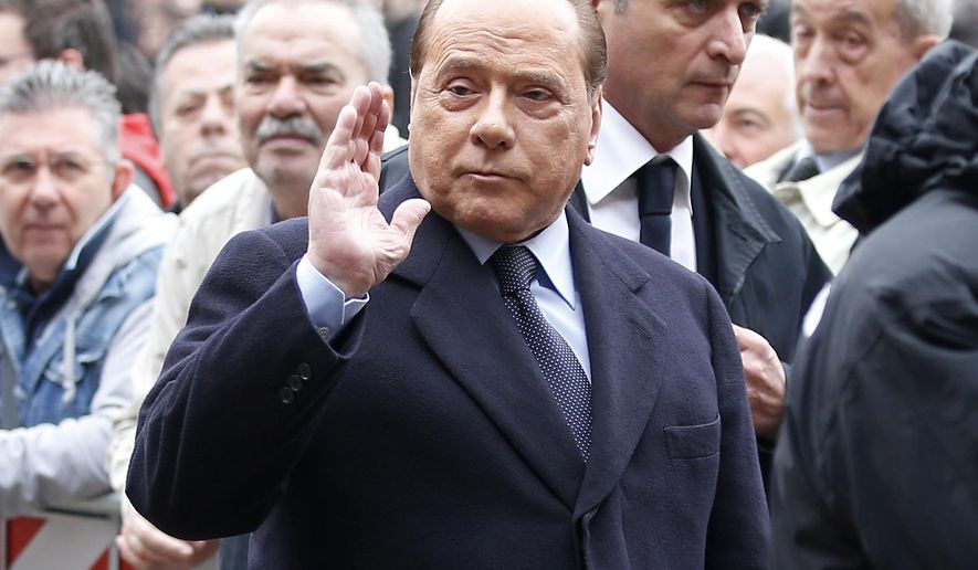FILE- In this Tuesday, April 5, 2016 file photo, former Premier Silvio Berlusconi attends the funeral of Italy coach Cesare Maldini at the Sant Ambrogio's Basilica in Milan, Italy. Berlusconi has been hospitalized for scheduled tests after doctors discovered a small irregular heartbeat during an earlier appointment. (AP Photo/Antonio Calanni, File)