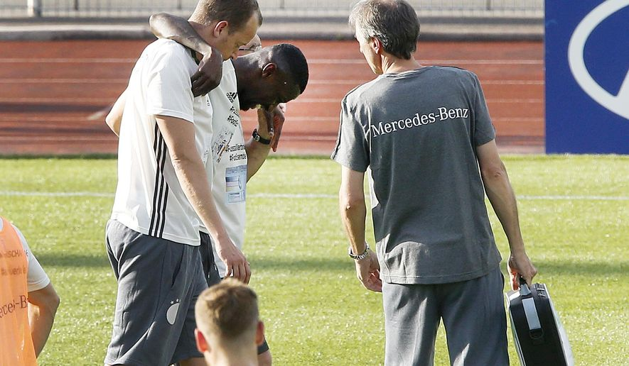 Antonio Ruediger is led off the pitch after he was injured during a training session of the German team in the Camille Fournier stadium at their base camp in Evian, France, Tuesday, June 7, 2016. Germany will face the Ukraine in a Euro 2016 Group C soccer match in Lille on Sunday, June, 12, 2016. (AP Photo/Michael Probst)