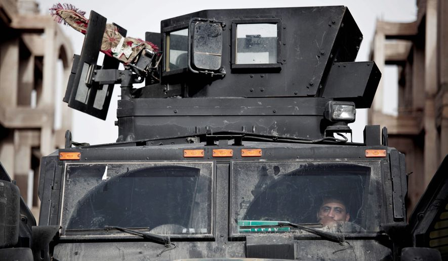 An Iraqi special operations soldier monitors radio traffic in Fallujah, which has been under siege by the Islamic State group for two years. U.S. advisers say major battlefield losses to the militant group could trigger headline-grabbing terrorist attacks during the holy month of Ramadan.