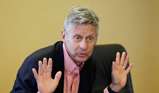 Libertarian presidential candidate and former New Mexico Gov. Gary Johnson speaks with legislators at the Utah State Capitol in Salt Lake City in this May 18, 2016, file photo. (AP Photo/Rick Bowmer, File)