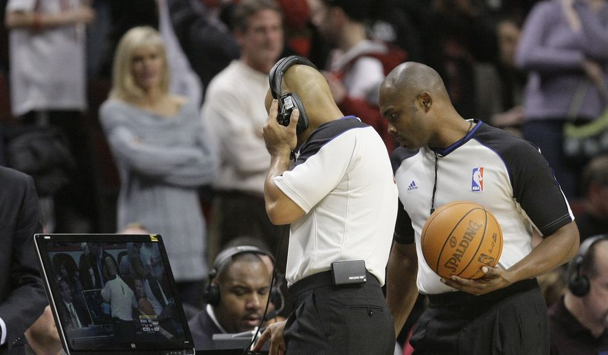 NBA game officials begin an instant replay review during the second half of an NBA basketball game between the Chicago Bulls and the Oklahoma City Thunder Monday, Dec. 6, 2010, in Chicago. (AP Photo/Charles Rex Arbogast)
