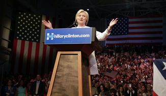 Democratic presidential candidate Hillary Clinton speaks during a presidential primary election night rally, Tuesday, June 7, 2016, in New York.  (AP Photo/Julie Jacobson)