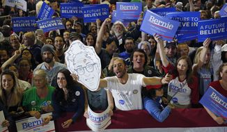People cheer for Democratic presidential candidate Sen. Bernie Sanders, I-Vt., at a rally Tuesday, June 7, 2016, in Santa Monica, Calif. (AP Photo/John Locher)