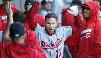 Washington Nationals' Stephen Drew celebrates in the dugout after his home run off Chicago White Sox starting pitcher James Shields during the second inning of a baseball game Wednesday, June 8, 2016, in Chicago. (AP Photo/Charles Rex Arbogast)