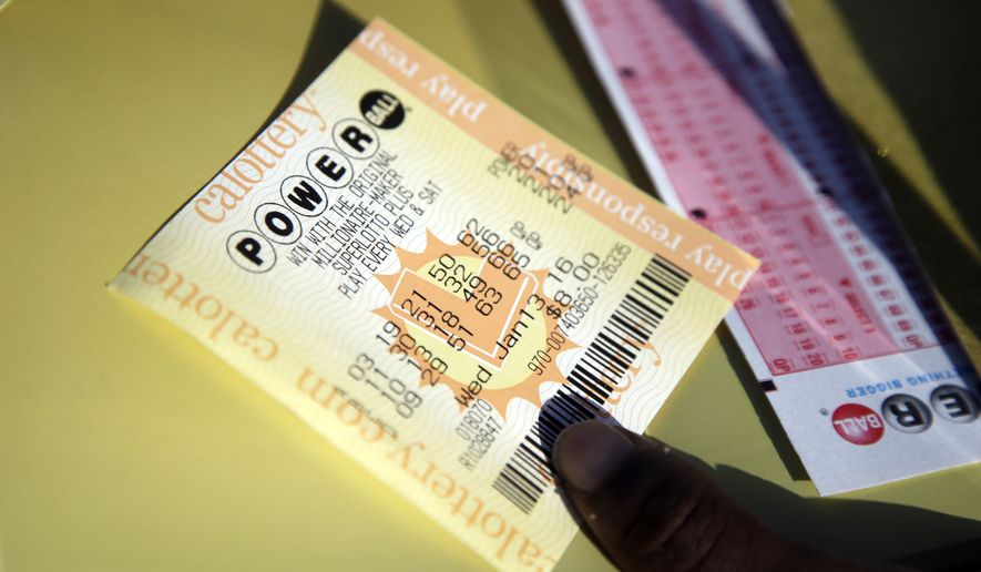 A Powerball ticket is shown Wednesday, Jan. 13, 2016, in San Lorenzo, Calif. The Powerball jackpot for Wednesday night's drawing is at least $1.5 billion, the largest lottery jackpot in the world. (AP Photo/Marcio Jose Sanchez)
