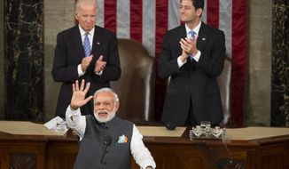Vice President Joe Biden and House Speaker Paul Ryan of Wis. applaud Indian Prime Minister Narendra Modi during his address to a joint meeting of Congress on Capitol Hill in Washington, Wednesday, June 8, 2016. (AP Photo/Evan Vucci)