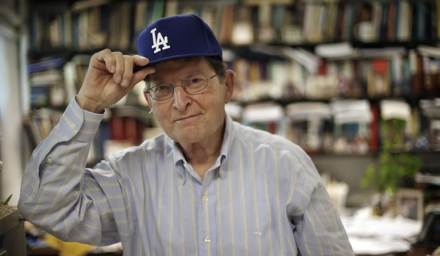 ADDS  HAMILTON WAS PART OF A TEAM - Physics professor, and lifelong fan of the Los Angeles Dodgers and Brooklyn Dodgers, Joe Hamilton poses in his Dodgers cap in his office at Vanderbilt University Wednesday, June 8, 2016, in Nashville, Tenn. Hamilton, was part of a team that discovered a new element and named  tennessine after Tennessee, making it the second element named after a state. Californium is the first. (AP Photo/Mark Humphrey)