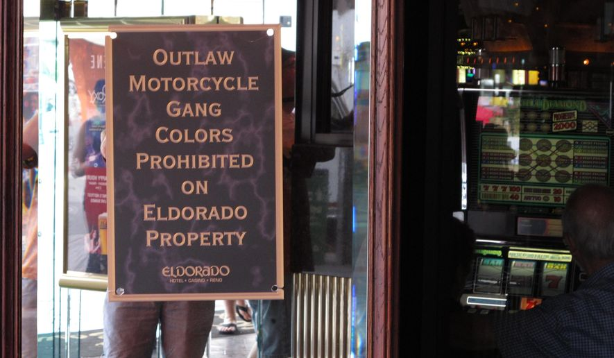 This photo taken Saturday, June 4, 2016, shows one of the signs posted at the Eldorado hotel-casino in Reno, Nev., during a Street Vibrations motorcycle festival warning that gang members cannot wear their colors. Most area casinos adopted the policy after a fatal shootout between rival gangs in Sparks in September 2011. Former Vagos leader Ernesto Gonzalez was found guilty of murder, but the Nevada Supreme Court overturned the conviction and his retrial is pending. (AP Photo/By Scott Sonner).
