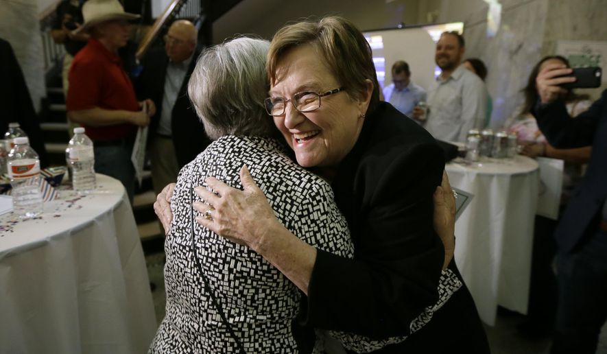 Iowa Democratic candidate for U.S. Senate former Iowa Lt. Gov. Patty Judge, right, gets a hug from a supporter during a primary night rally, Tuesday, June 7, 2016, in Des Moines, Iowa. (AP Photo/Charlie Neibergall)