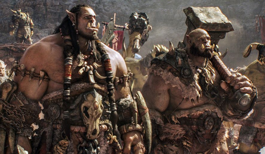 """This image released by Universal Pictures shows characters Orc chieftain Durotan, voiced by Toby Kebbell, left, and  Orgrim, voiced by Rob Kazinsky, in a scene from the film, """"Warcraft,"""" based on the Blizzard Entertainment video game. (Universal Pictures via AP)"""