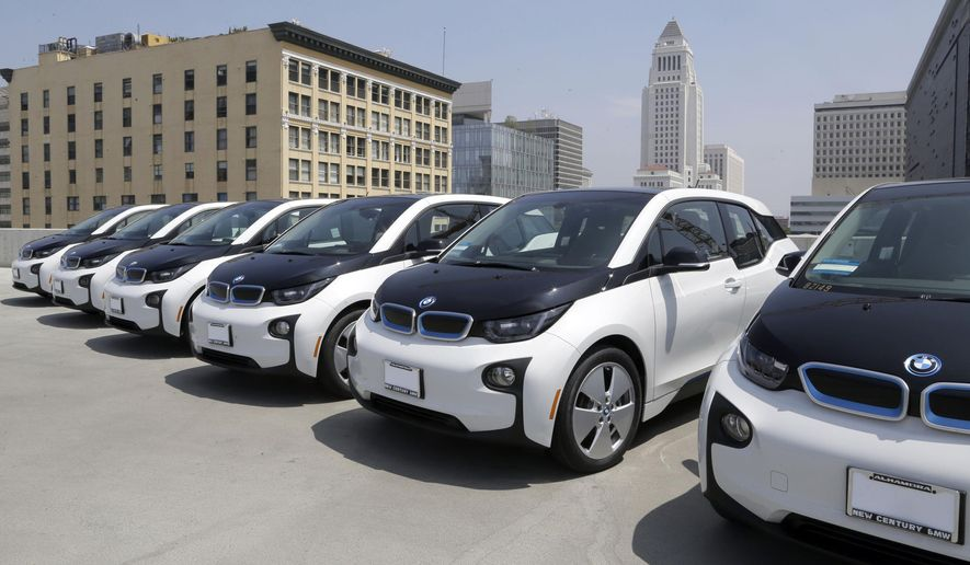 Electric cars are parked atop the Los Angeles Police Department parking lot, in Los Angeles on Wednesday, June 8, 2016. The Los Angeles Police Department has added 100 electric cars to its fleet as replacements for aging vehicles. The newly leased additions to the department motor pool announced Wednesday are BMW i3 models. The cars are not for regular police patrols. They will largely be used by the department's civilian work force and sometimes by officers. (AP Photo/Nick Ut)