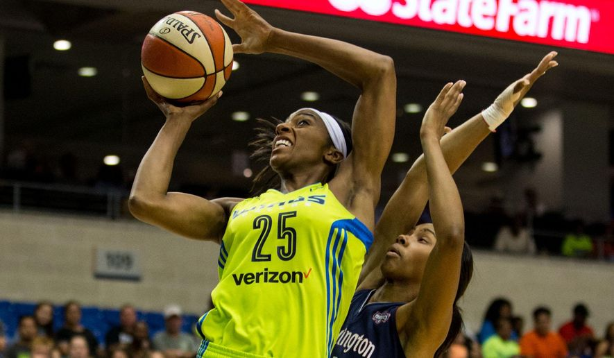 Dallas Wings forward Glory Johnson (25) shoots pass Washington Mystics guard Tayler Hill (4) during the first quarter of a WNBA basketball game at College Park Center, Wednesday, June 8, 2016 in Arlington, Texas. (Ting Shen/The Dallas Morning News via AP) MANDATORY CREDIT; MAGS OUT; TV OUT; INTERNET USE BY AP MEMBERS ONLY; NO SALES