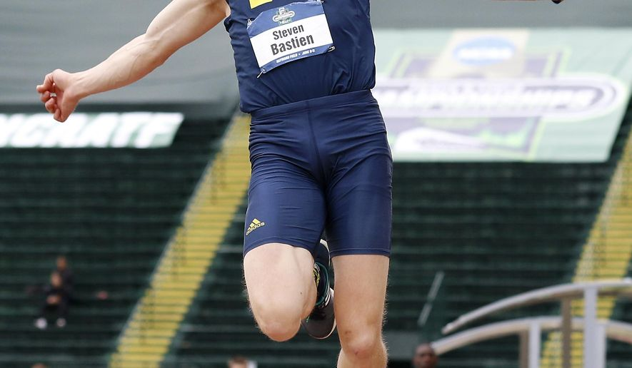 Michigan's Steven Bastien competes in the long jump event in the decathlon competition at the NCAA track and field championships in Eugene, Ore., Wednesday, June 8, 2016. (AP Photo/Ryan Kang)