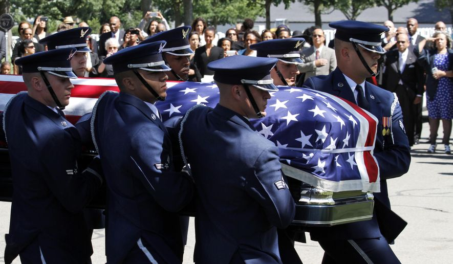A U.S. Air Force Honor Guard casket team carries the remains of Tuskegee Airman Mal Whitfield at Arlington National Cemetery, Wednesday, June 8, 2016, in Arlington, Va. Whitfield was the first service member to win a gold medal while on active duty and also helped the U.S. win the 1,600 meter relay title in 1948. He successfully defended his 800 meter title in 1952. Whitfield, 91, died in November in Washington. (AP Photo/Paul Holston)