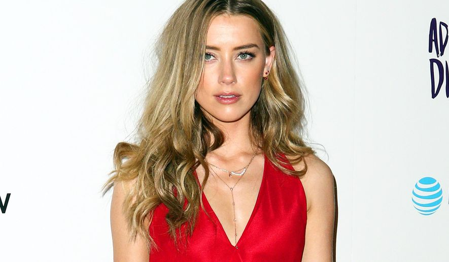 "FILE - In this April 12, 2016 file photo, Amber Heard attends the LA Premiere of ""The Adderall Diaries"" in Los Angeles. (Photo by John Salangsang/Invision/AP, File)"