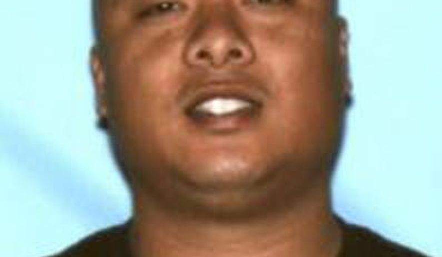 This undated photo provided by the Honolulu Police Department shows Officer Jessie Laconsay. The Honolulu Police Department is asking for help locating Laconsay, who is a suspect in a first-degree sexual assault investigation. Police said in a news release Wednesday, June 8, 2016, that off-duty Officer Laconsay may be driving a white Dodge Charger. (Honolulu Police Department via AP)
