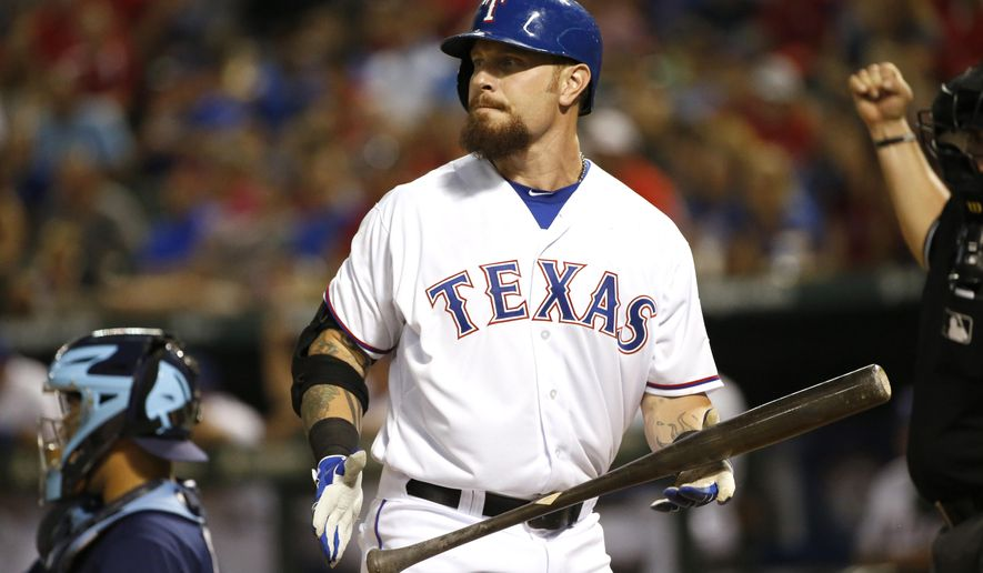 FILE - In this Aug. 15, 2015, file photo, Texas Rangers' Josh Hamilton looks away after striking out in a baseball game against the Tampa Bay Rays in Arlington, Texas. Hamilton, who was already out of the season, had ACL reconstruction surgery in left knee, Wednesday, June 8, 2016, in Houston, the team announced. (AP Photo/Ron Jenkins, File)