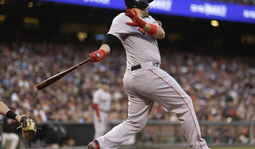 Boston Red Sox Xander Bogaerts swings for an RBI single off San Francisco Giants pitcher Albert Suarez in the third inning of a baseball game Tuesday, June 7, 2016, in San Francisco. (AP Photo/Ben Margot)