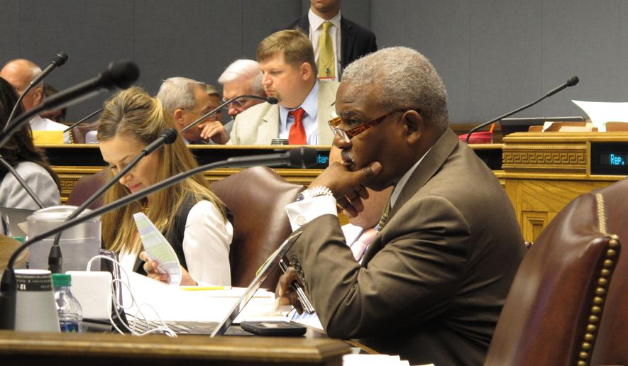Rep. Joe Bouie, D-New Orleans, listens to testimony about tax bills during a hearing of the House Ways and Means Committee, on Wednesday, June 8, 2016, in Baton Rouge, La. Gov. John Bel Edwards called on lawmakers Tuesday to raise millions of dollars more in taxes aimed at closing budget holes and stopping cuts to health care services and education programs. But his package of revenue-raising proposals quickly hit snags in the House Ways and Means Committee.    (AP Photo/Melinda Deslatte)