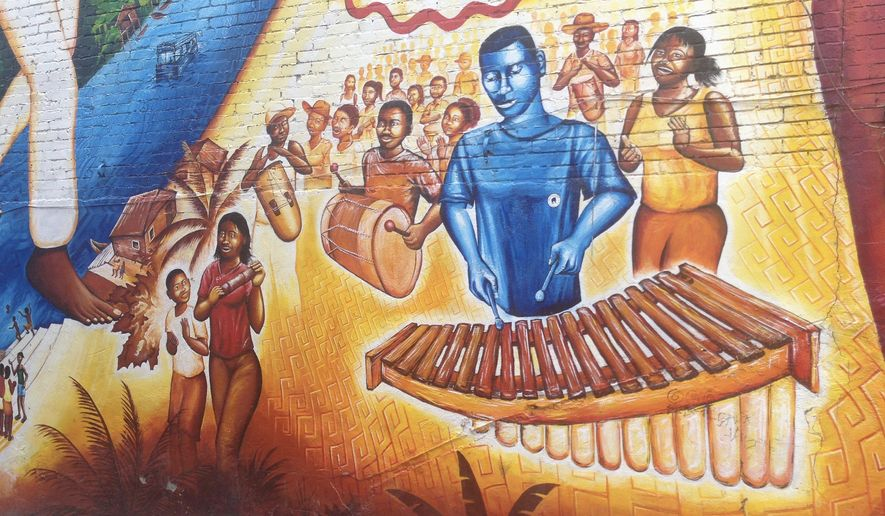 While Travis Gardner, 32, of the Brass Connection Band plays to a crowd in Georgetown, a mural on U Street serves only as a memory for some of the District's oldest jazz clubs. (Faith E. Pinho/The Washington Times)