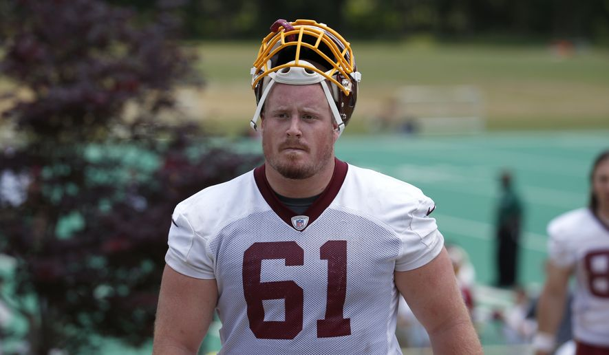 Washington Redskins guard Spencer Long (61) departs after practice at the team's NFL football training facility at Redskins Park, Wednesday, June 1, 2016 in Ashburn, Va. (AP Photo/Alex Brandon)